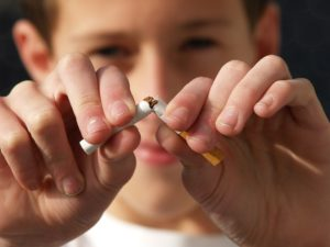 Smoking cigarettes affects oral health